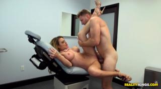 Busty Nurse Corinna Blake Gets Fucked On Bed