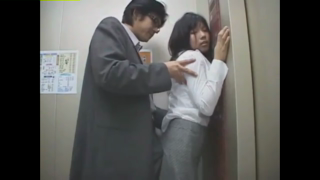 Japanese brunette is having a lot of fun in an elevator, with a handsome stranger